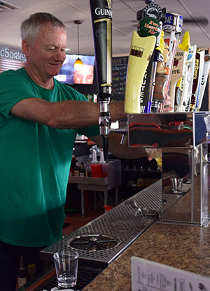 Bartender Getting Beer