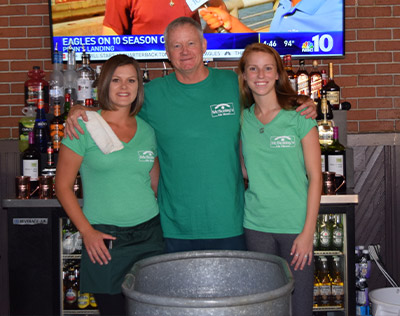 Friendly Staff Photo behind the bar