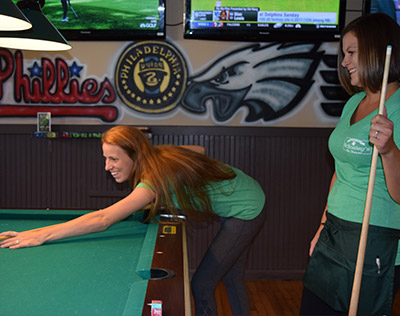 Bartenders playing pool