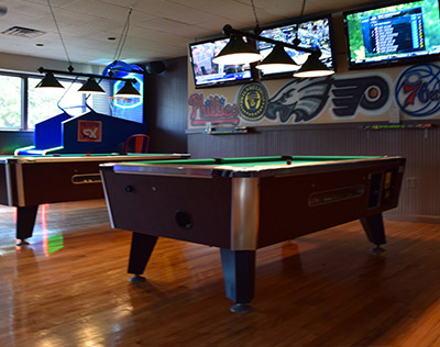 View of Two Pool Tables at the Bar